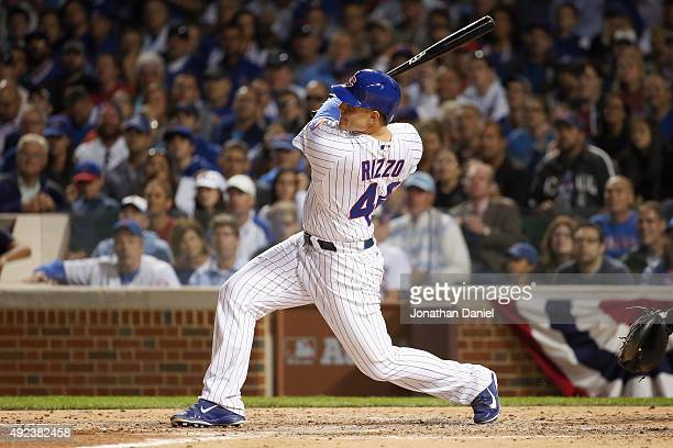 Anthony Rizzo of the Chicago Cubs hits a solo home run in the fifth inning against the St Louis Cardinals during game three of the National League...