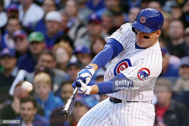 Anthony Rizzo of the Chicago Cubs hits a solo home run in the sixth inning against the St Louis Cardinals during game four of the National League...