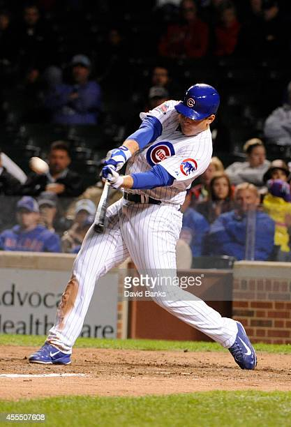 Anthony Rizzo of the Chicago Cubs hits a walkoff home run in the ninth inning against the Cincinnati Reds on September 15 2014 at Wrigley Field in...