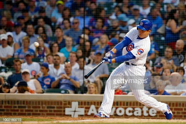 Anthony Rizzo of the Chicago Cubs hits an RBI double against the St Louis Cardinals to score Victor Caratini during the fifth inning at Wrigley Field...