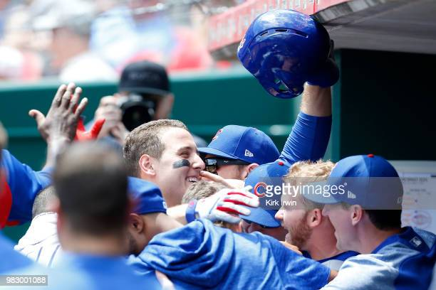 Anthony Rizzo of the Chicago Cubs is congratulated by his teammates after hitting a tworun home run during the fifth inning of the game against the...