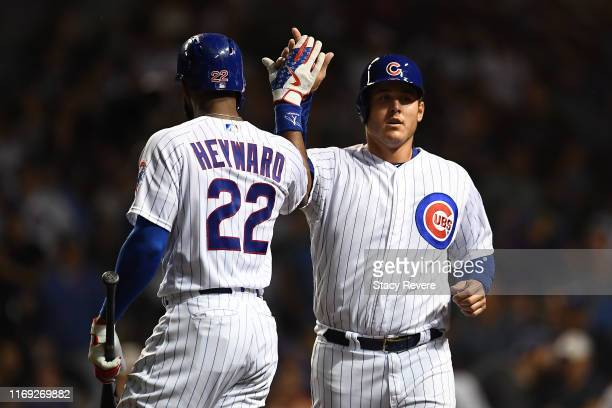 Anthony Rizzo of the Chicago Cubs is congratulated by Jason Heyward after scoring a run against the San Francisco Giants during the seventh inning at...