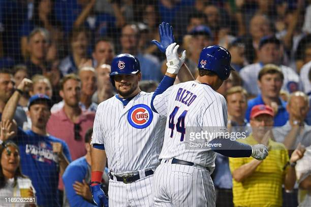 Anthony Rizzo of the Chicago Cubs is congratulated by Kyle Schwarber following a home run against the San Francisco Giants during the third inning at...