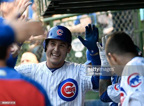 Anthony Rizzo of the Chicago Cubs is greeted by his teammates after hitting a home run against the Philadelphia Phillies during the second inning on...
