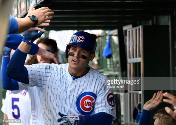 Anthony Rizzo of the Chicago Cubs is greeted in the dugout after hitting a two run home run against the Miami Marlins during the fifth inning at...