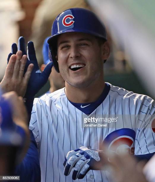 Anthony Rizzo of the Chicago Cubs is greeted in the dugout after hitting a grand slam home run in the 1st inning against the Cincinnati Reds at...