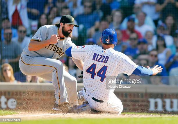Anthony Rizzo of the Chicago Cubs is tagged out at home by Clay Holmes of the Pittsburgh Pirates during the fifth inning of a game at Wrigley Field...