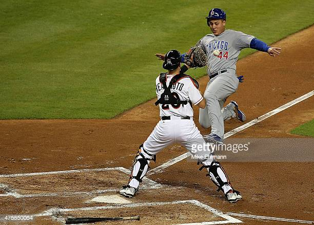 Anthony Rizzo of the Chicago Cubs is tagged out at home by JT Realmuto of the Miami Marlins during a game at Marlins Park on June 1 2015 in Miami...
