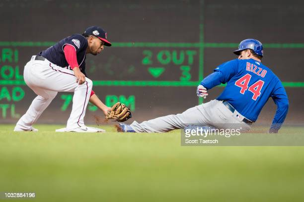 Anthony Rizzo of the Chicago Cubs is tagged out at second by Adrian Sanchez of the Washington Nationals during the first inning at Nationals Park on...