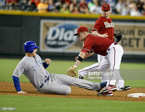 Anthony Rizzo of the Chicago Cubs is tagged out by Aaron Hill of the Arizona Diamondbacks after being caught off the base on a Alfonso Soriano...