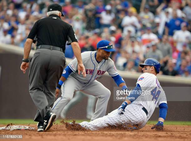 Anthony Rizzo of the Chicago Cubs is tagged out by Robinson Cano of the New York Mets trying to advance to second base in the fifth inning at Wrigley...