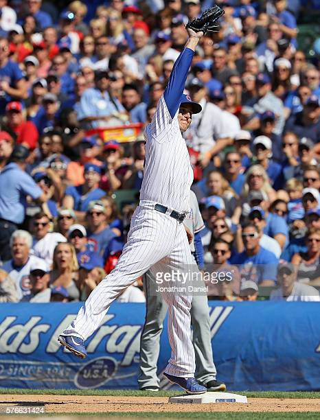 Anthony Rizzo of the Chicago Cubs leaps to make a catch to force Bobby Wilson of the Texas Rangers at first base in the 8th inning at Wrigley Field...