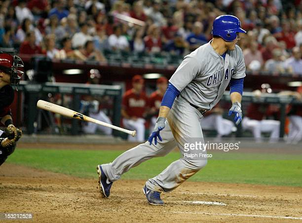 Anthony Rizzo of the Chicago Cubs lines a double to the outfield against the Arizona Diamondbacks during a MLB game at Chase Field on September 30...