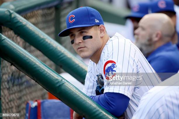 Anthony Rizzo of the Chicago Cubs looks on from the dugout before game three of the National League Division Series against the Washington Nationals...