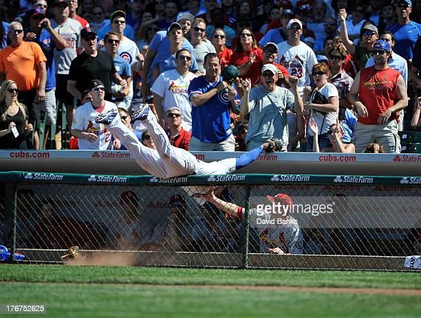Anthony Rizzo of the Chicago Cubs makes a catch on Yadier Molina of the St Louis Cardinals during the fifth inning on August 18 2013 at Wrigley Field...