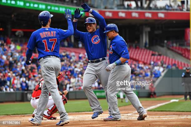 Anthony Rizzo of the Chicago Cubs middle celebrates with Kris Bryant of the Chicago Cubs and Kyle Schwarber of the Chicago Cubs after hitting a...