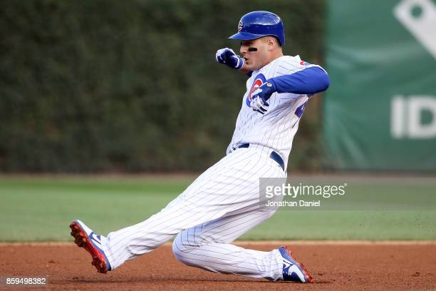 Anthony Rizzo of the Chicago Cubs reaches second base on an error in the fourth inning against the Washington Nationals during game three of the...