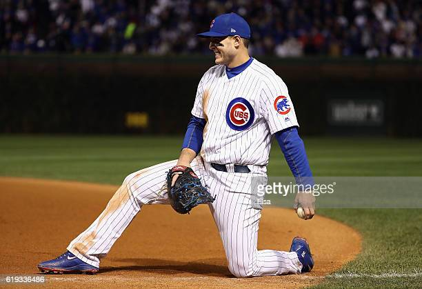 Anthony Rizzo of the Chicago Cubs reacts after fielding a ground ball in the eighth inning against the Cleveland Indians in Game Five of the 2016...