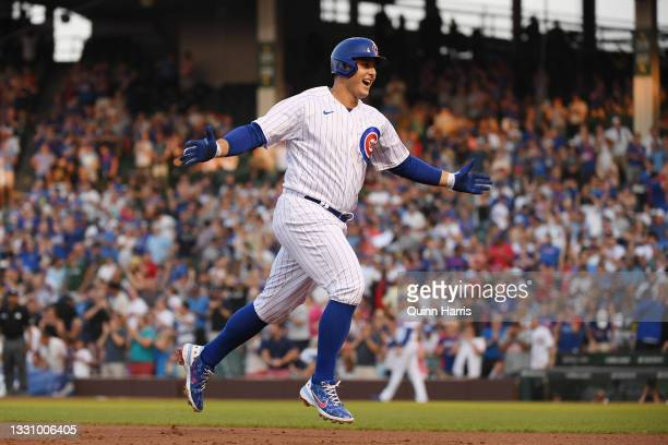 Anthony Rizzo of the Chicago Cubs reacts after his home run in the first inning against the Cincinnati Reds at Wrigley Field on July 27, 2021 in...