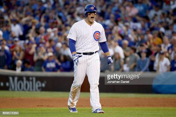 Anthony Rizzo of the Chicago Cubs reacts after hitting a single in the eighth inning against the Washington Nationals during game three of the...