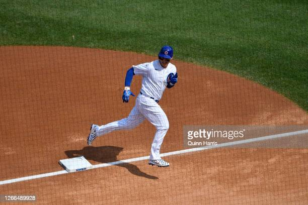 Anthony Rizzo of the Chicago Cubs reacts after hitting a solo home run in the first inning against Milwaukee Brewers at Wrigley Field on August 15,...