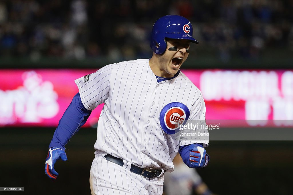 Anthony Rizzo #44 of the Chicago Cubs reacts as he runs the bases after hitting a solo home run in the fifth inning against the Los Angeles Dodgers during game six of the National League Championship Series at Wrigley Field on October 22, 2016 in Chicago, Illinois.