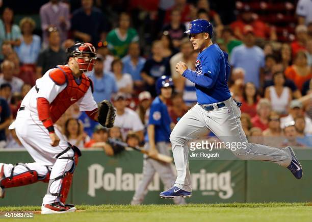 Anthony Rizzo of the Chicago Cubs reacts as he scores the goahead run in the 9th inning against the Boston Red Sox at Fenway Park on July 1 2014 in...