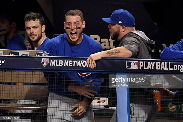 Anthony Rizzo of the Chicago Cubs reacts in the dugout after Willson Contreras hit an RBI double to score Ben Zobrist during the fourth inning...