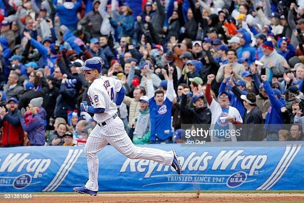Anthony Rizzo of the Chicago Cubs rounds the bases after hitting a three run home run against the Pittsburgh Pirates during the fourth inning at...