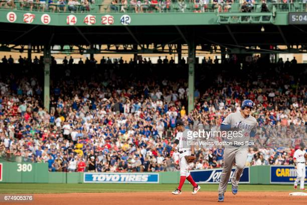 Anthony Rizzo of the Chicago Cubs rounds the bases after hitting a two run home run during the fourth inning of a game against the Boston Red Sox on...
