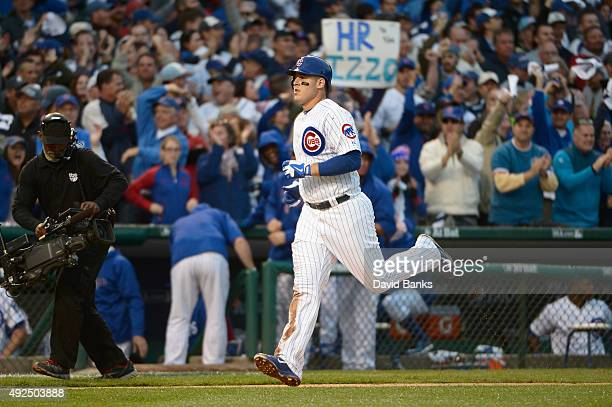 Anthony Rizzo of the Chicago Cubs runs the bases after hitting a solo home run in the sixth inning against the St Louis Cardinals during game four of...