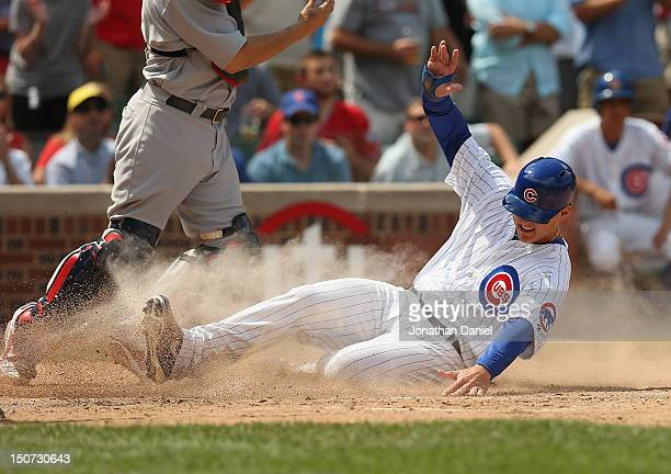 Anthony Rizzo of the Chicago Cubs slides in to score a run against the St Louis Cardinals at Wrigley Field on July 27 2012 in Chicago Illinois The...