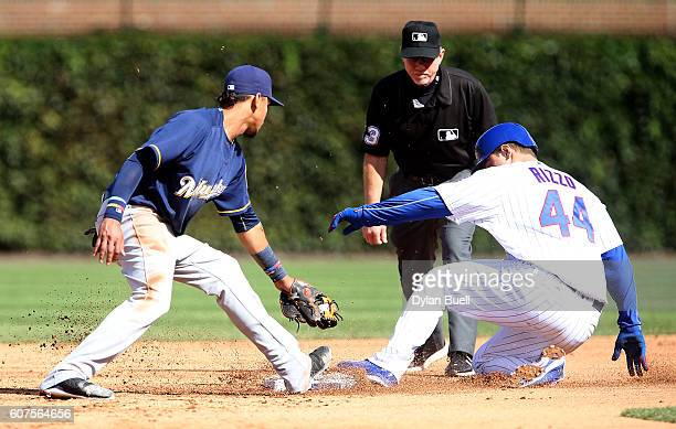 Anthony Rizzo of the Chicago Cubs slides into second base for a double past Orlando Arcia of the Milwaukee Brewers in the fifth inning at Wrigley...