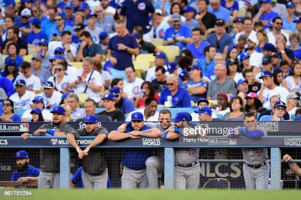 Anthony Rizzo of the Chicago Cubs stands with teammates in the dugout during game two of the National League Championship Series against the Los...