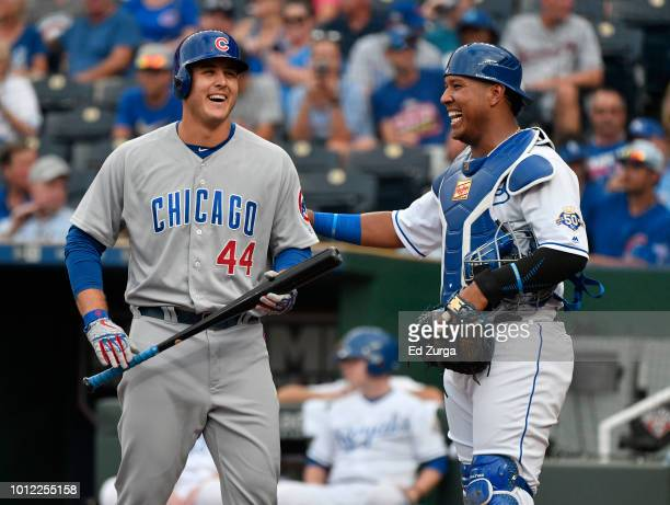 Anthony Rizzo of the Chicago Cubs talks with Salvador Perez of the Kansas City Royals before batting in the first inning at Kauffman Stadium on...