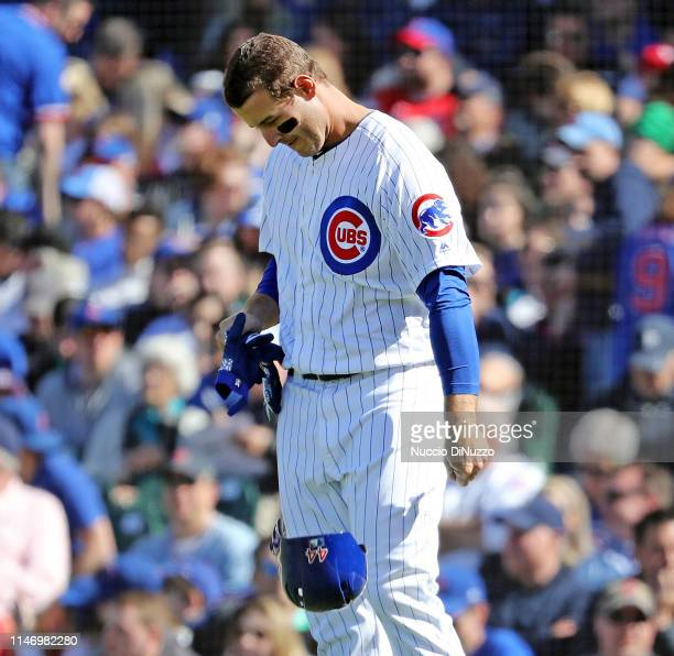 Anthony Rizzo of the Chicago Cubs throws his helmet after a ground out during the third inning of a game against the St Louis Cardinals at Wrigley...