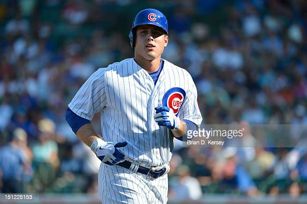 Anthony Rizzo of the Chicago Cubs trots off the field against the Milwaukee Brewers at Wrigley Field on August 30 2012 in Chicago Illinois The Cubs...