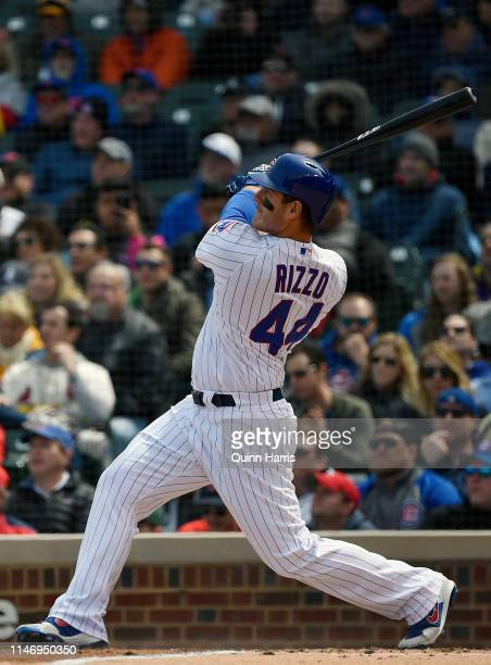 Anthony Rizzo of the Chicago Cubs watches his three run home run ball leave the park in the third inning against the St. Louis Cardinals at Wrigley...