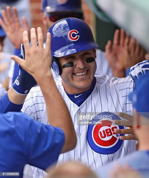 Anthony Rizzo of the Chicago Cubsis congratulated in the dugout after hitting a two run home run in the 4th inning against the Pittsburgh Pirates at...