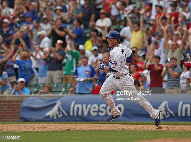 Anthony Rizzo of the Chicago Cubsyells as he runs the bases after hitting a two-run, walk-off home run in the 10th inning against the St. Louis...