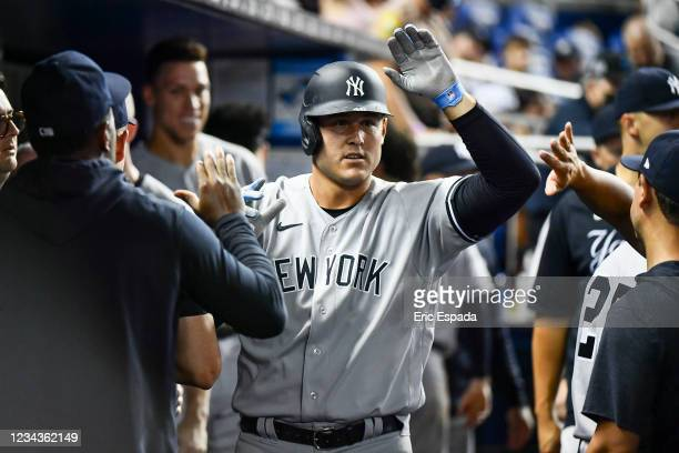 Anthony Rizzo of the New York Yankees celebrates with teammates after hitting a home run in the seventh inning against the Miami Marlins at loanDepot...