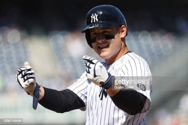 Anthony Rizzo of the New York Yankees gestures to the dugout after hitting a single in the bottom of the fifth inning of a game against the Toronto...