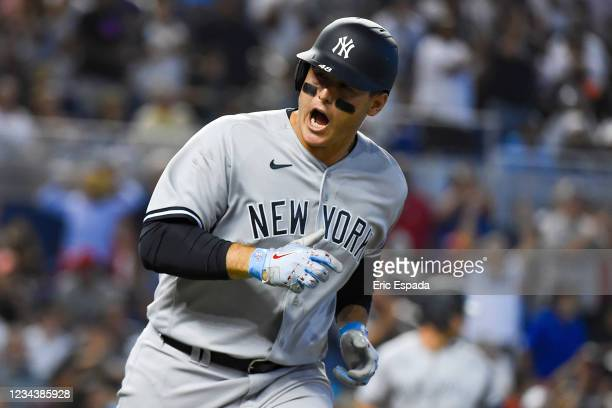 Anthony Rizzo of the New York Yankees reacts towards the bench after hitting an RBI single in the eighth inning against the Miami Marlins at...