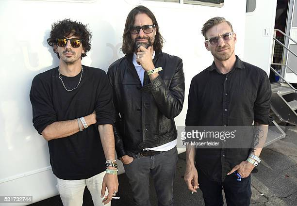 Anthony Rossomando Andrew Wyatt and Pontus Winnberg of Miike Snow pose during KROQ's Weenie Roast at Irvine Meadows Amphitheatre on May 14 2016 in...