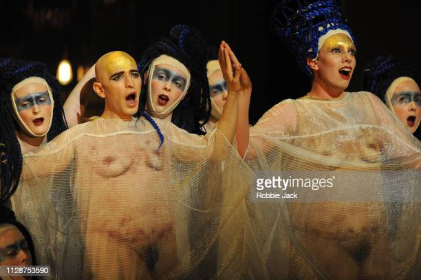 Anthony Roth Costanzo as Akhnaten and Katie Stevenson as Nefertiti with artists of the company in English National Opera's production of Philip...