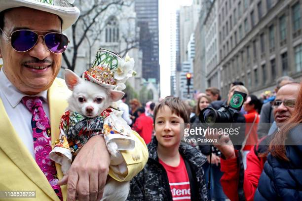 Anthony Rubio holds his Chihuahua dog Kimba in Midtown East during the annual Easter Parade on April 21 2019 in New York City Each year New Yorkers...