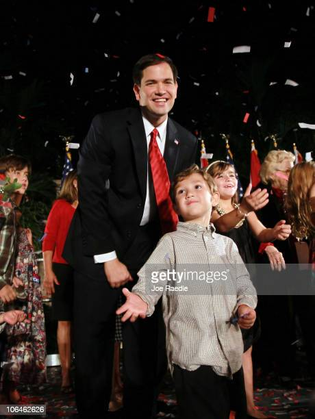 Anthony Rubio stands with his father Republican nominee for Florida US Senator Marco Rubio during his Reclaim America Victory Celebration at the...