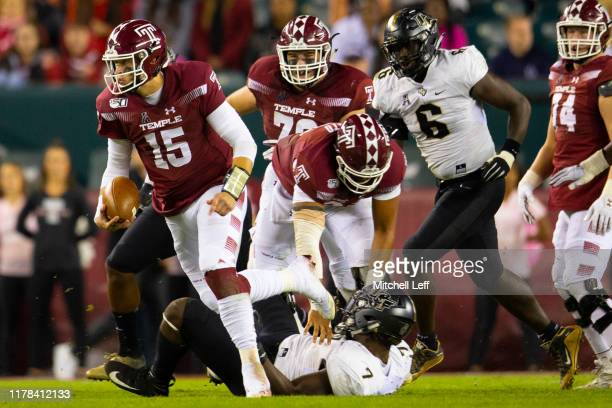 Anthony Russo of the Temple Owls runs the ball past Kenny Turnier and Brendon Hayes of the UCF Knights in the second quarter at Lincoln Financial...