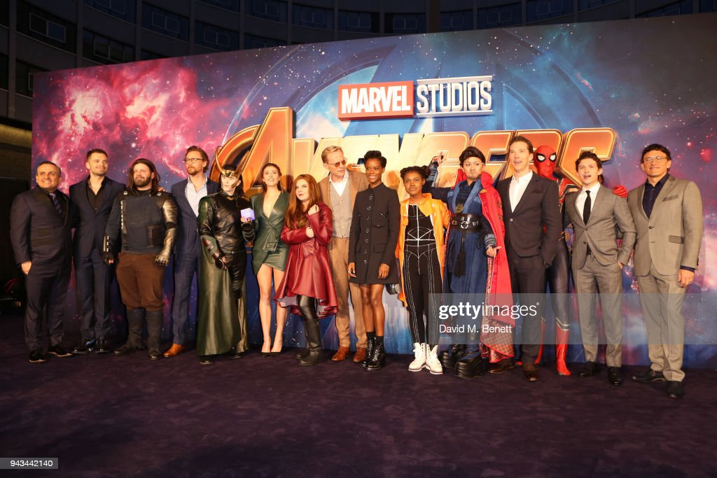 Anthony Russo, Sebastian Stan, guest, Tom Hiddleston, guest, Elizabeth, guest, Olsen, Paul Bettany, Letitia Wright, guest, guest, Benedict Cumberbatch, guest, Tom Holland and Joe Russo attend the UK Fan Event for 'Avengers: Infinity War' at the Television Studios White City on April 8, 2018 in London, England.
