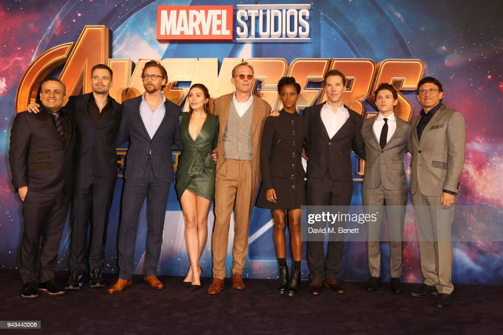 Anthony Russo, Sebastian Stan, Tom Hiddleston, Elizabeth Olsen, Paul Bettany, Letitia Wright, Benedict Cumberbatch, Tom Holland and Joe Russo attend the UK Fan Event for 'Avengers: Infinity War' at the Television Studios White City on April 8, 2018 in London, England.